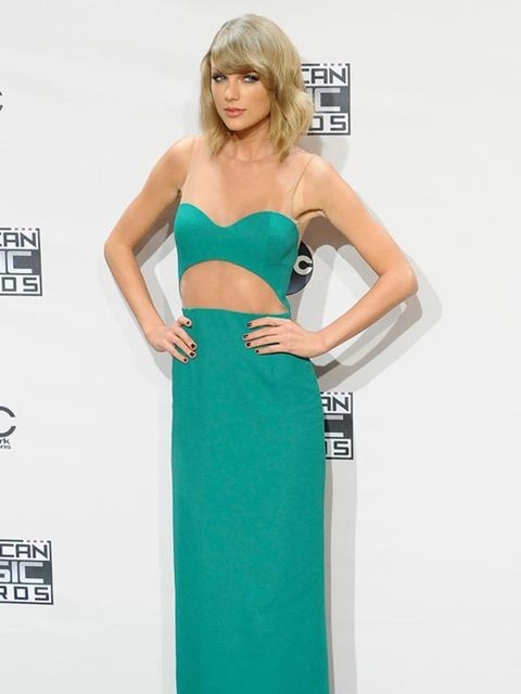 <p>Taylor Swift wears Michael Kors and Jimmy Choo at the American Music Awards in LA, November 2014.</p>