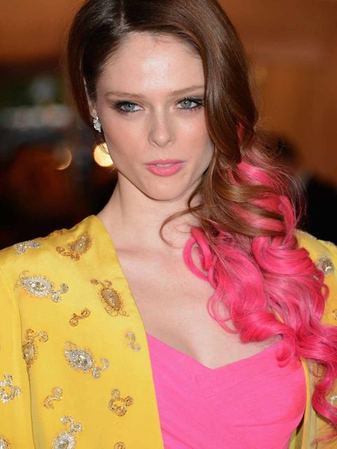 <p>Coco matches her pink lips to her bright hair extensions at the 2012 MET Ball</p>