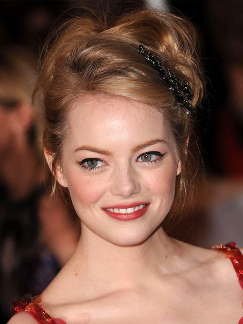 <p>Emma Stone wearing a hair accessory at the Met Ball 2012</p>