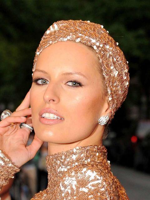 <p>Karolina Kurkova makes a statement with her glittering hair band at the Met Ball 2012</p>