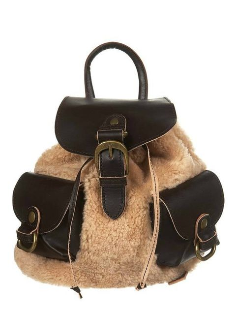 "<p>Satisfy your hunger for shearling with Topshop's sheepskin rucksack. A huge trend for a/w and a practical piece that will look great with an aviator jacket. <a href=""Small%20Sheepskin%20Rucksack%20"">Topshop</a> rucksack, £75 </p>"