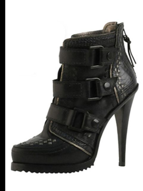 """<p>Boots, £150 by<a href=""""http://xml.riverisland.com/flash/content.php""""> River Island</a></p>"""