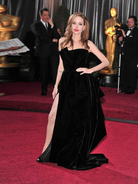 """<p><a href=""""http://www.elleuk.com/star-style/celebrity-style-files/angelina-jolie"""">Angelina Jolie</a> wearing an <a href=""""http://www.elleuk.com/catwalk/designer-a-z/versace/couture-ss-2012"""">Atelier Versace</a> gown with <a href=""""http://www.elleuk.com/fash"""