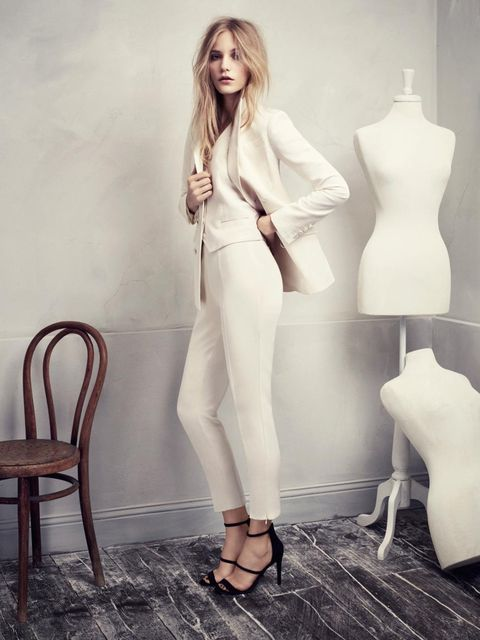 <p>This classic three-piece suit has a feminine twist with its fitted blazer and high-waisted trousers</p>