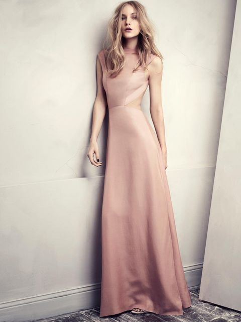 <p>This elegant floor-length pink gown has a dramatic, entirely open back</p>