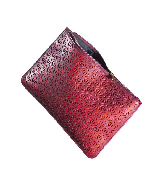 <p>Next and ELLE's senior fashion editor, Natalie Wansborough-Jones, have teamed up to design ELLE's take on the brand's best-selling, laser-cut clutch. Here we show you three ways to style it: the Traveller girl&#x3B; the Tech chic girl&#x3B; and the Girl about to