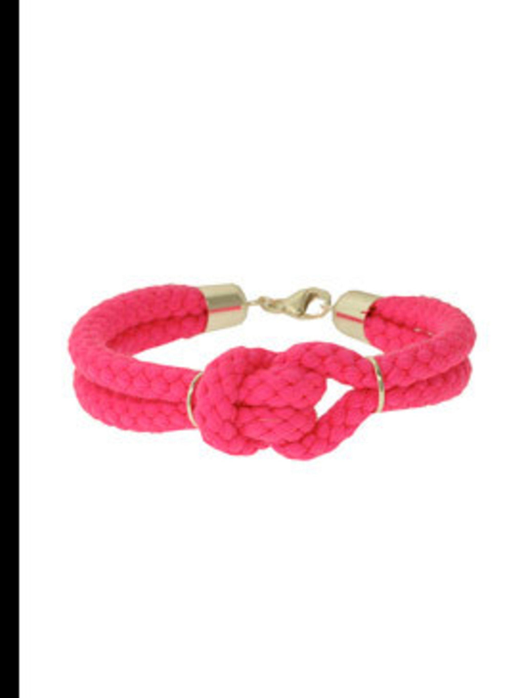"<p>Bracelet, £64 by Sabrine Dehoff at <a href=""http://www.kabiri.co.uk/jewellery/bracelets/small_knotted_cord_braceletpink"">Kabiri</a></p>"