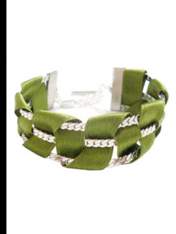 """<p>Bracelet, £81 by Wear and Tear at <a href=""""http://www.kabiri.co.uk/jewellery/bracelets/weave_silk_tape_braceletgreen"""">Kabiri</a></p>"""
