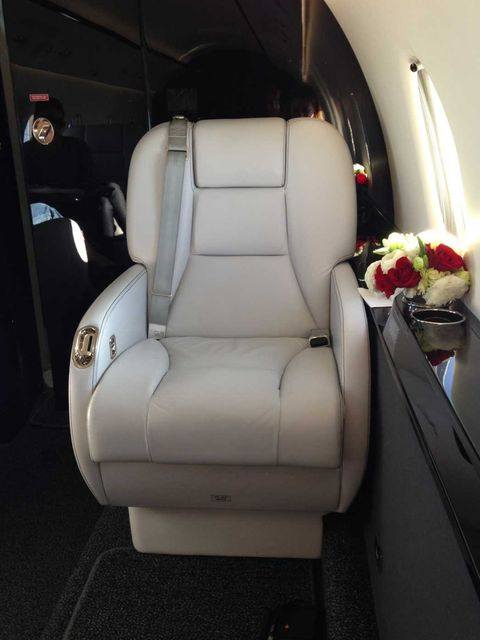 <p>White leather chairs on swivel settings - the seats on offer when travelling by private jet. The red rose posies were a nice touch too. Easyjet, eat your heart out.</p>