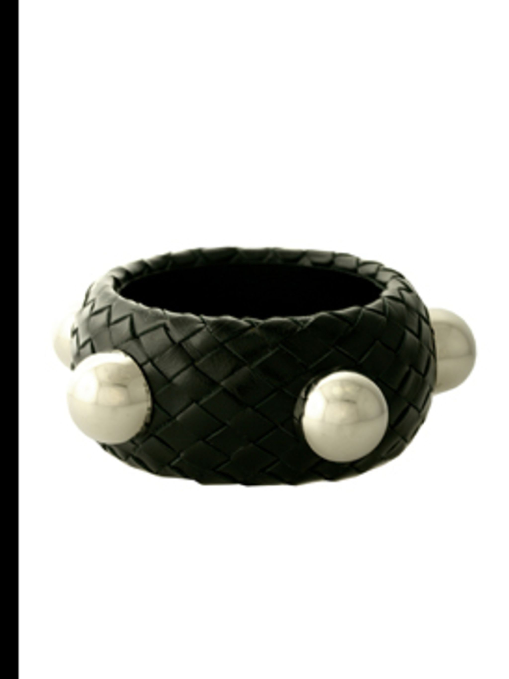 "<p>Studded Bangle, £115 by <a href=""http://www.kabiri.co.uk/jewellery/bracelets/woven_banglesilver_stud"">CC Skye</a></p>"