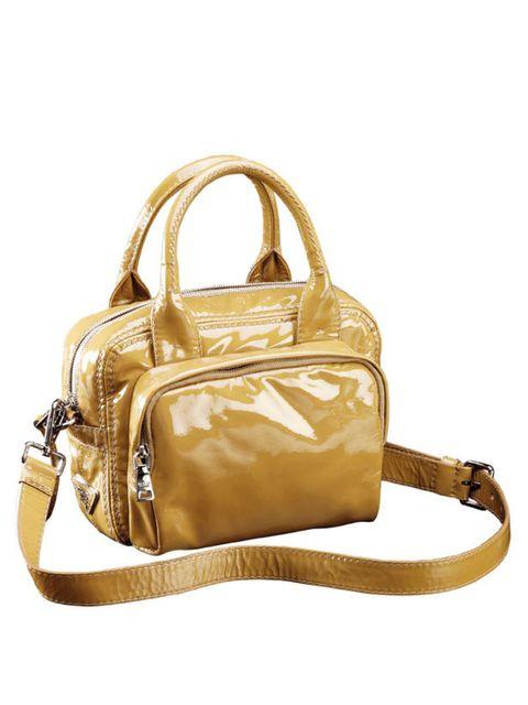 """<p><a href=""""http://www.prada.com/en/UK/e-store/"""">Prada</a> patent leather top handle bag, £810</p>"""