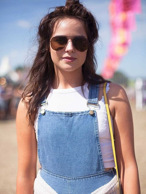 <p>Hannah Wright wears a River Island top, vintage dungarees and Tesco sunglasses.</p>