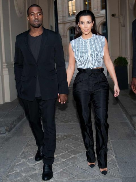 <p>Kim Kardashian and Kanye West at the Givenchy Haute Couture by Riccardo Tisci show</p>