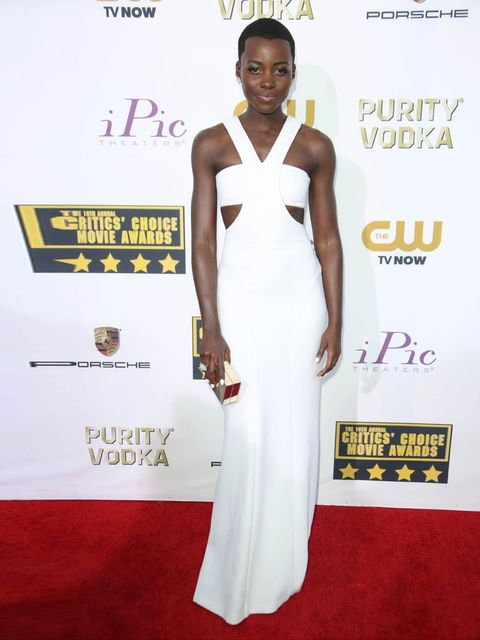 "<p><a href=""http://www.elleuk.com/star-style/celebrity-style-files/lupita-nyong-o-style-file-actress-miu-miu-chanel-couture"">Lupita Nyong'o</a> wears a custom Calvin Klein Collection dress styled with a Calvin Klein Collection clutch, Paul Andrew custom s"