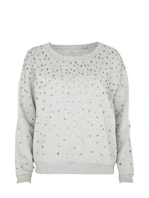 "<p> </p><p> </p><p>Styled with everything from a maxi skirt to leather shorts, this embellished sweater will be a winter staple. <a href=""http://www.riverisland.com/Online/women/tops/casual-tops/grey-cluster-jewel-sweat-top-596067"">River Island</a> grey e"
