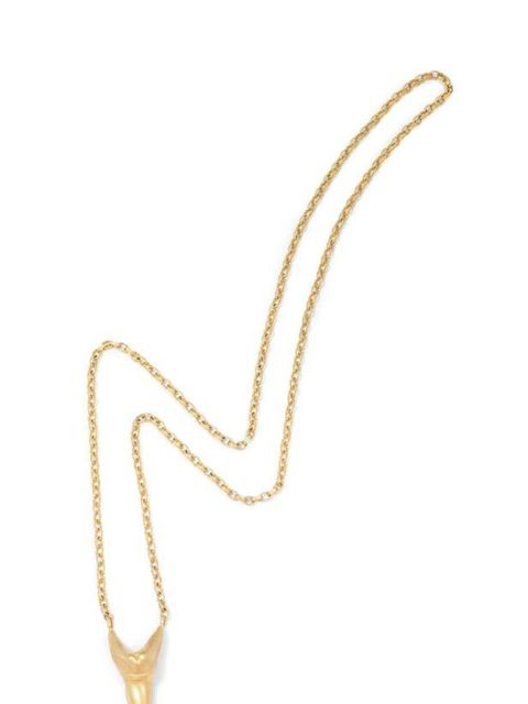 """<p>Swap the festive statement necklaces for something more subtle like this uber-cool fang necklace - perfect for giving luxe edge to jersey basics. Hannah Warner gold fang necklace, £170, at <a href=""""http://www.seftonfashion.com/shopping/cat-necklaces/it"""