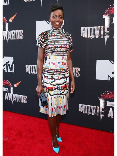 "<p><a href=""http://www.elleuk.com/star-style/celebrity-style-files/lupita-nyong-o-style-file-actress-miu-miu-chanel-couture"">Lupita Nyong'o</a> wears a Chanel dress and Casadei shoes to the 2014 MTV Movie Awards.</p>"