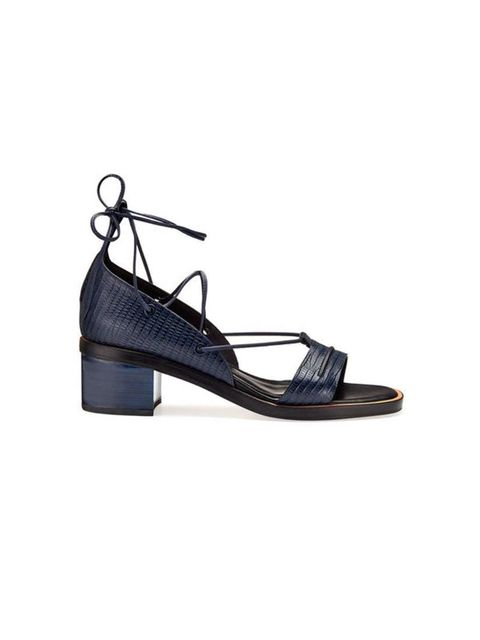 "<p>Pair with culottes to show off all that ankle-strap action.</p>  <p><a href=""http://www.whistles.com/women/shoes/sandals/nevine-two-part-lacing-sandal-20498.html?dwvar_nevine-two-part-lacing-sandal-20498_color=Navy"" target=""_blank"">Whistles</a> sandals"