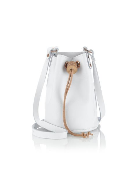 """<p>Think of this as a grown-up beach bucket. Just don't fill it with sand.</p><p>Alfie Douglas bucket bag, £140, from <a href=""""http://www.avenue32.com/whats-new/white-alfie-eight-mini-duffle-bag-19501.html"""">Avenue32.com</a></p>"""