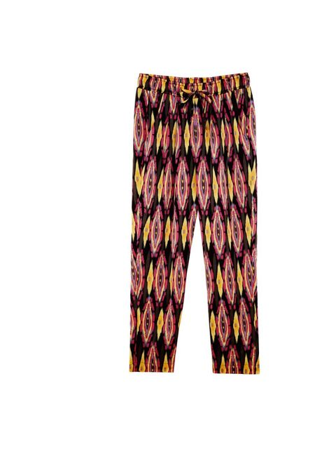 <p>Vaudeville & Burlesque printed trousers, £65, at Urban Outfitters, for stockists call 0203 219 1944</p>