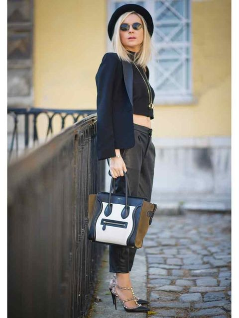 <p>Aysun Karaalioglu is wearing a jacket from Mango, G-Star hat, vintage sunglasses, Celine bag and Valentino shoes </p>