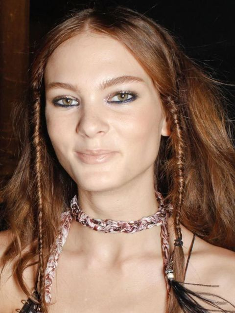 """<p>Plaits, rope braids and fishtail plaits all made an appearance on the Milan catwalks. Odile Gilbert masterminded a beautiful summer hairstyle at <a href=""""http://www.elleuk.com/catwalk/collections/moschino/"""">Moschino</a> with a plait hairband working it"""