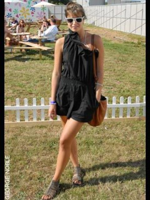 <p>Anne, 21, wearing a Topshop playsuit with shoes from a shop in India</p>