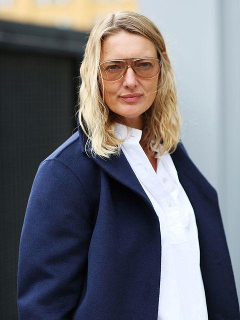 Rebecca Lowthorpe – ELLE Collections Editor/Assistant Editor ELLE  Prada pea jacket, Eudon Choi blouse, Miu Miu trousers, Gucci loafers.