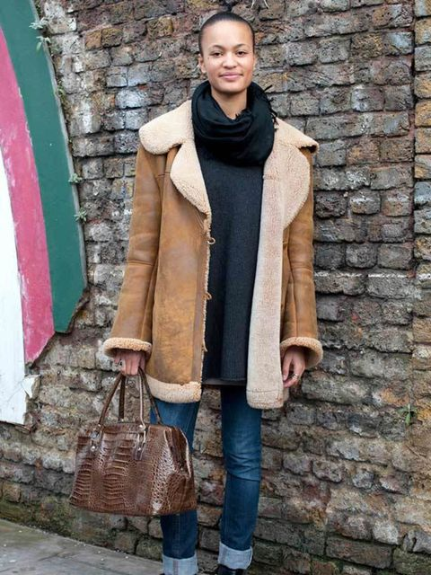 <p>Photo by Kirstin Sinclair.Lisa, 20, Student. Vintage coat & bag, Zara jumper, H&M jeans & scarf, boots from Italy. </p>