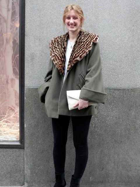 <p>Photo by Silvia Olsen.Rosalind, 22, intern. Vintage coat, Primark leggings, LF Soho boots. </p>