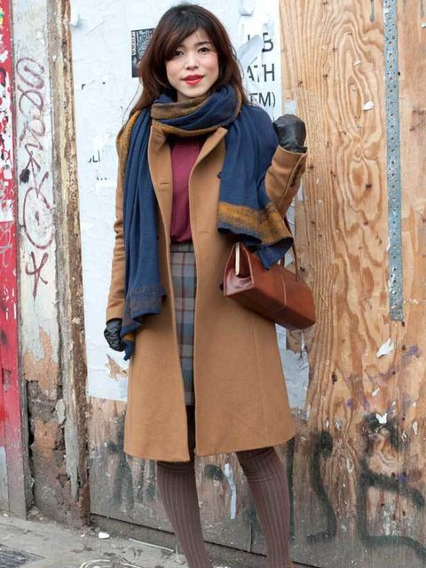<p>Photo by Silvia Olsen.Megumi, 26, Model. Zara coat & scarf, vintage bag, top, skirt, Mango shoes, American Apparel tights. </p>