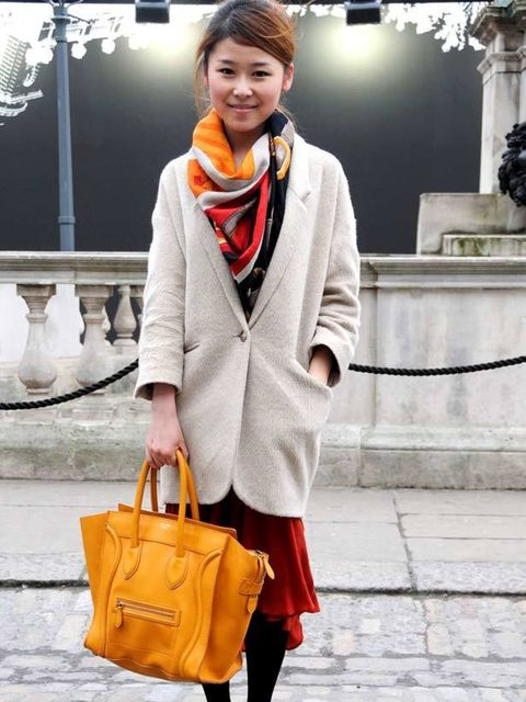 <p>Photo by Ekua King @ Anthea Simms.Mia, 24, Marketing Assistant. Topshop coat, Miss Selfridge dress, Hermes scarf, Chanel shoes, Celine bag</p>