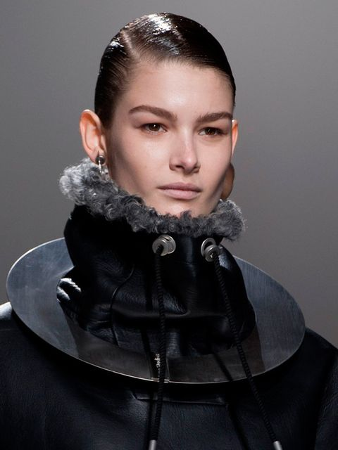 <p>Hair Stylist: Anthony Turner for L'Oreal Professionnel</p><p>Look: HIgh-shine ponytails to offset the earthy textures and knits in the collection.</p><p>Inspiration: Androgyny</p><p>Key Product: L'Oreal Professionnel Tecni.Art Glue</p><p>Tip: Use the g
