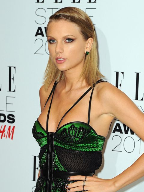 Taylor works her long bob with a strong side part.