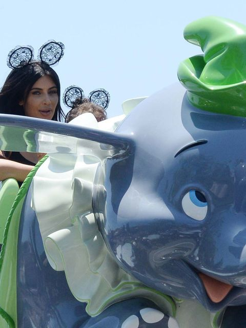 <p>Kim Kardashian and Kanye West take North on the Cars Ride as they are spotted celebrating her 2nd birthday at Disneyland California, June 2015.</p>