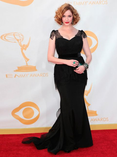 """<p><strong>Christina Hendricks in Christian Siriano </strong></p><p>'This is simply a very pretty black dress, cut to flatter her perfectly - see the lace covering on the arm, and the detail on the hip that kicks out into a fishtail.'</p><p><a href=""""http:"""