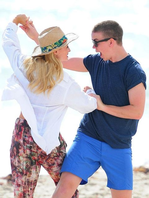 <p>Dancing on a beach, in the sunshine, with a beautiful woman… Jealous? Us? </p>
