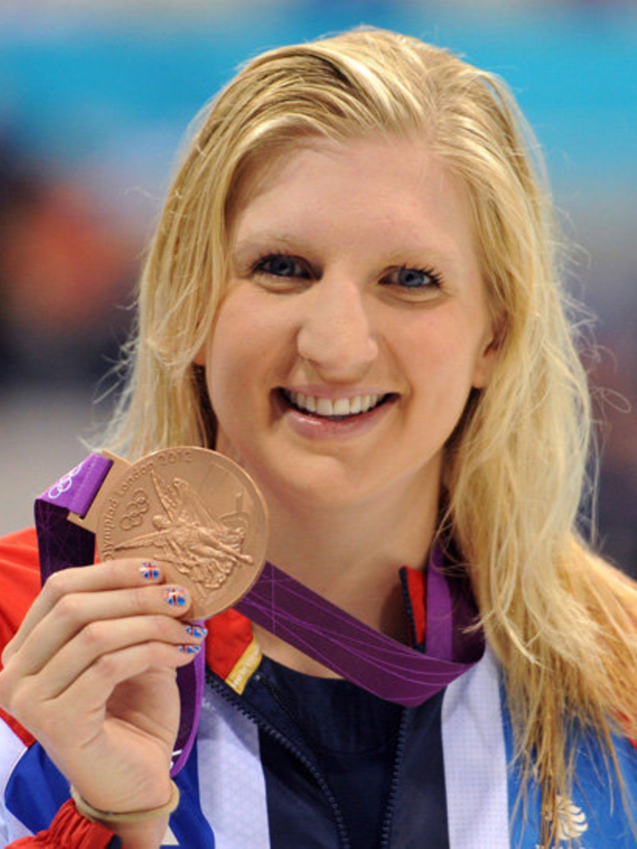 <p>Rebecca Adlington, with her bronze medal for the 400m Women's Freestyle Swimming and her Nail Porn nails</p>