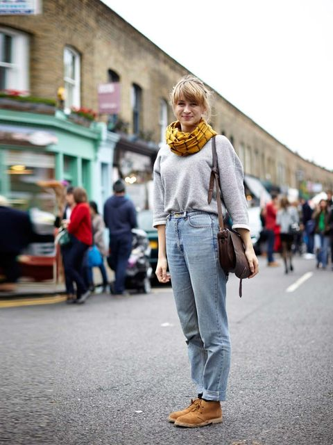 """<p>Isabel Crossman wearing jumper from America, American Apparel jeans, vintage boots from Brick Lane, brother's scarf.</p><p><em><a href=""""http://www.elleuk.com/style/street-style/best-of-spring-summer-2014-shows-street-style"""">SS14 fashion week street sty"""