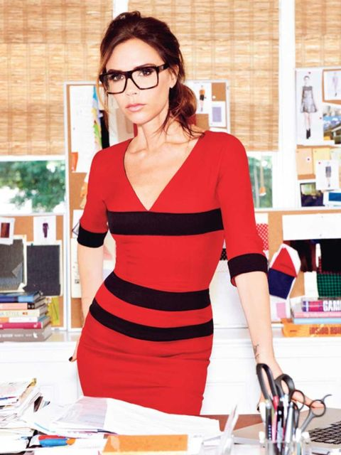 <p>Victoria Beckham wearing a pair of her new glasses and a dress of her own design</p>