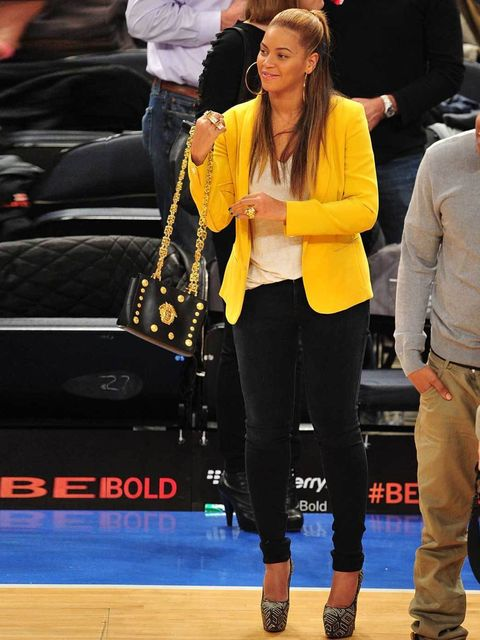 "<p><a href=""http://www.elleuk.com/star-style/celebrity-style-files/beyonce"">Beyonce</a> adding a splash of colour to her look with a yellow blazer, February 2012</p>"