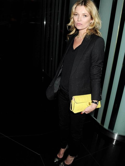 "<p><a href=""http://www.elleuk.com/star-style/celebrity-style-files/kate-moss"">Kate Moss</a> adds a splash of colour to her black ensemble with a classic yellow <a href=""http://www.elleuk.com/catwalk/designer-a-z/chanel/autumn-winter-2012/review"">Chanel</a"