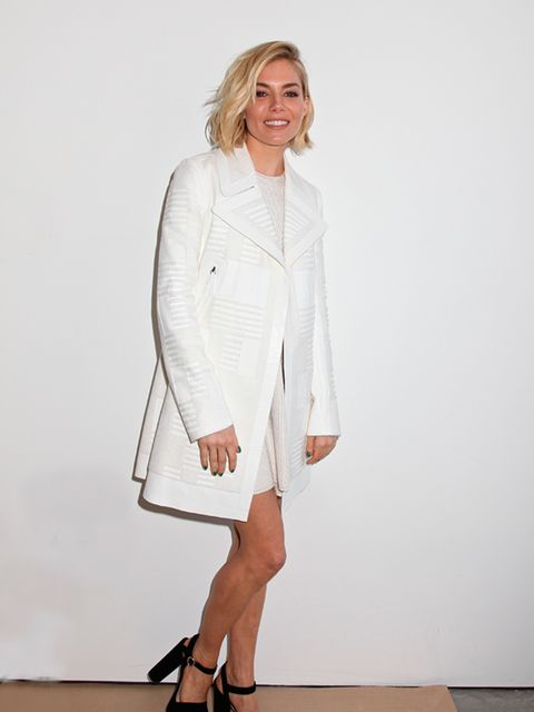 Sienna Miller poses backstage at the Calvin Klein a/w 2015 show.