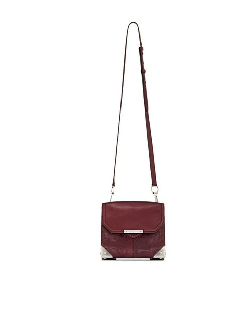 <p>Alexander Wang 'Marion' bag in oxblood printed lizard, price on request, Available at Dover Street Market, for stockists call 0207 518 0680</p>