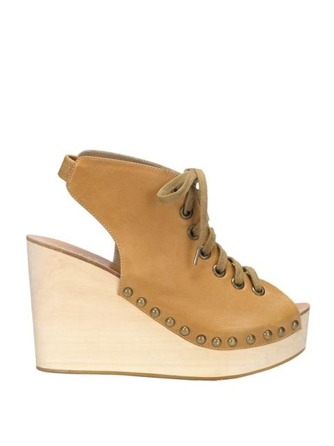 <p>Sandro leather and wooden platform wedge sandals, £290, for stockists call 0207 259 9539</p>