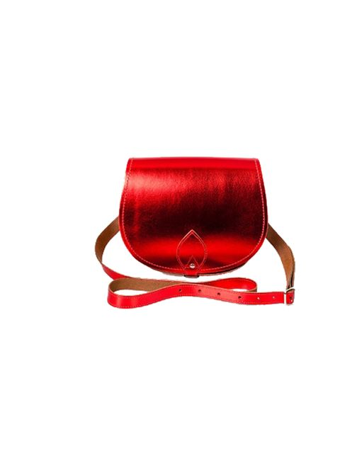 """<p>From the office to the party to the Christmas market, a hassle-free yet statement-inducing metallic bag is a festive must-have… <a href=""""http://www.zatchels.com/"""">Zatchels</a> red metallic saddle bag, £55</p>"""