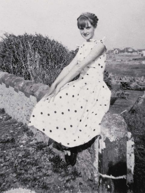 <p>'In a modelling mood at home, wearing an A-line dress, Tre-Arddur Bay, 1954'</p>