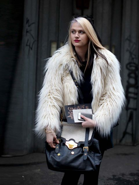 <p>Faux fur and statement bag (uncredited).</p>