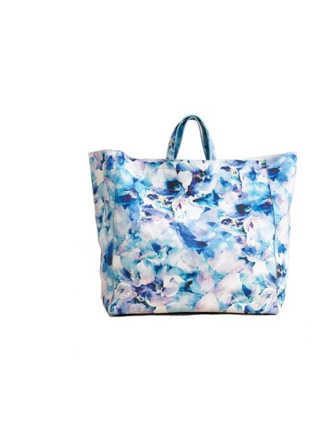 <p>Brighten up any look in a flash with this gorgeous leather tote… Taiuti printed tote, £180, at Fenwick, for stockists call 0207 629 9161</p>