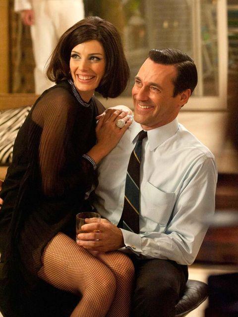 <p>Jessica Pare as Megan in that black dress, with Jon Hamm as Don Draper</p>